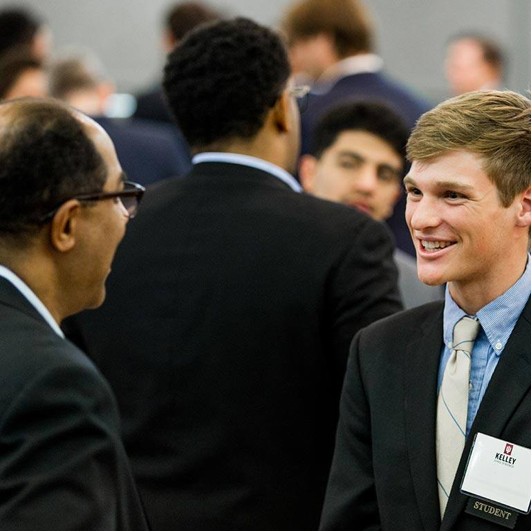 Two men speak at a career event.